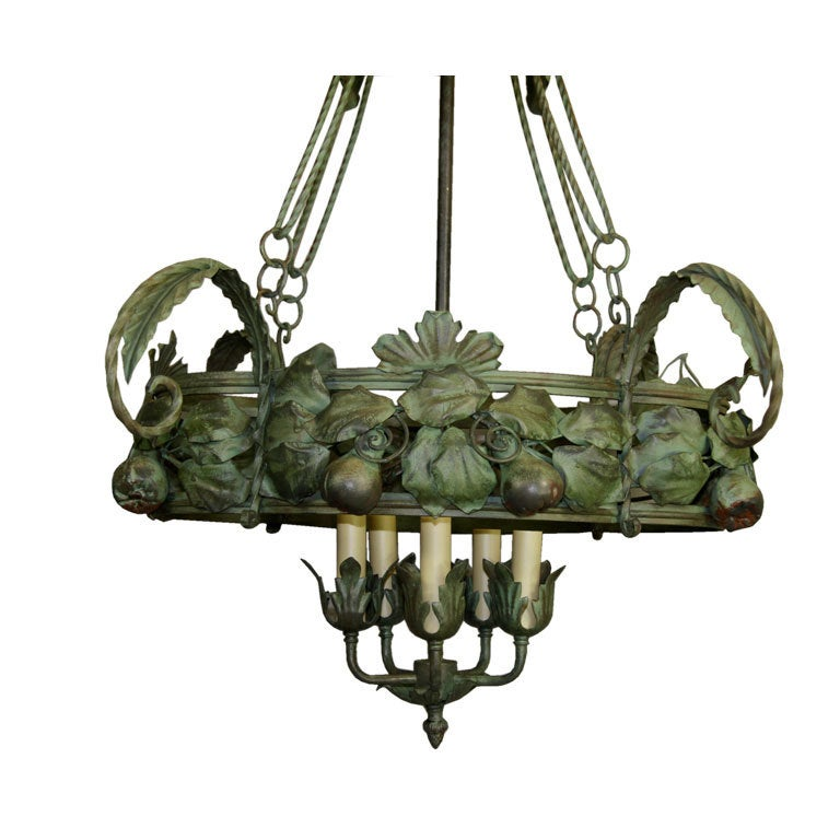 1-2420 A large tole and wrought iron foliate hand painted chandelier with 5 lite cluster.