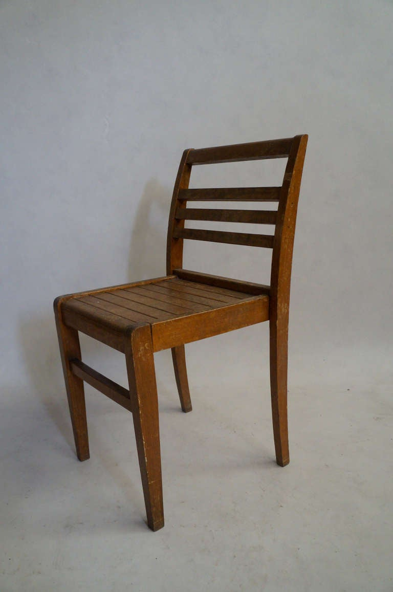 French Set of Four Rene Gabriel Oak Chairs For Sale