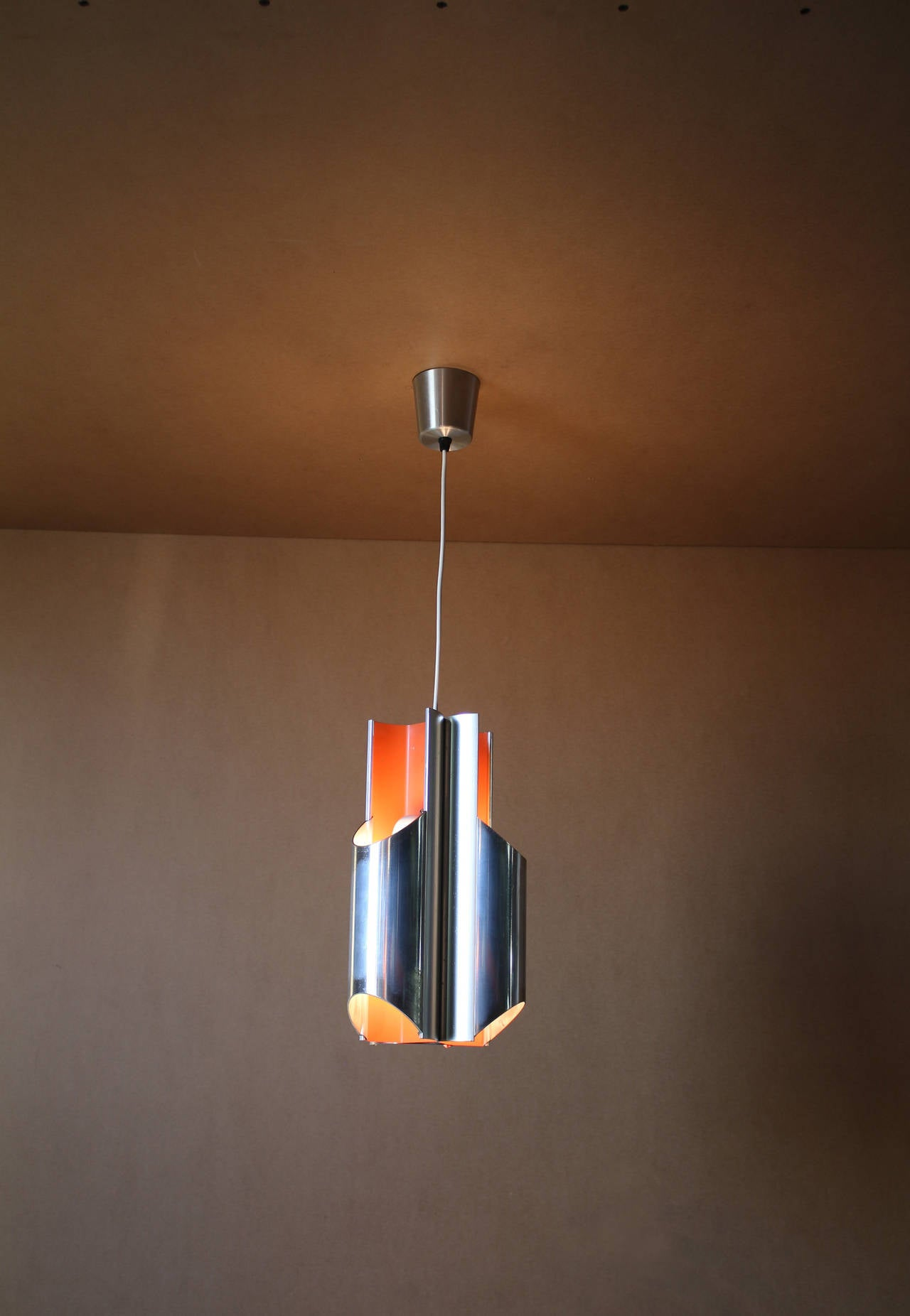 A 1960s Danish aluminium and orange enameled pendant by Bent Karlby for Lyfa (editor).