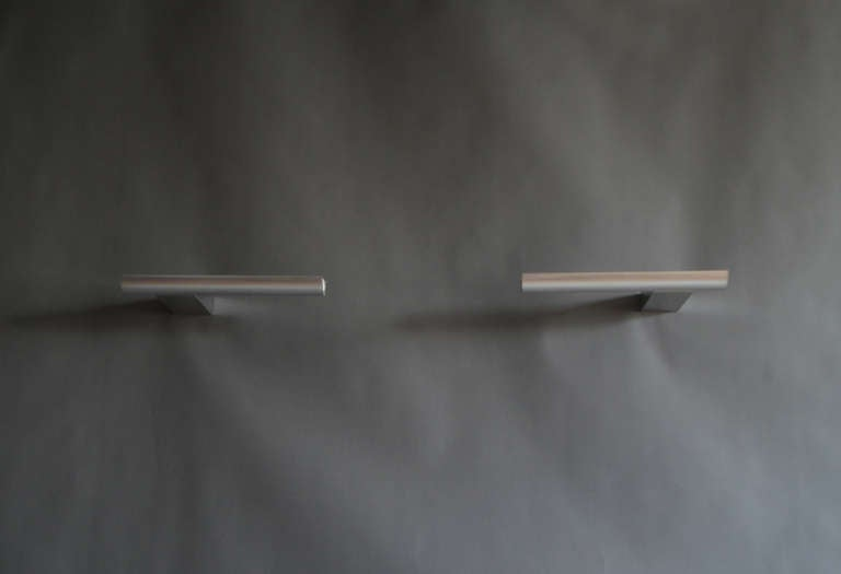 Ten Fine French 1970s aluminum sconces by Cesar Putzeys. One matching chandeliers available (see last picture).