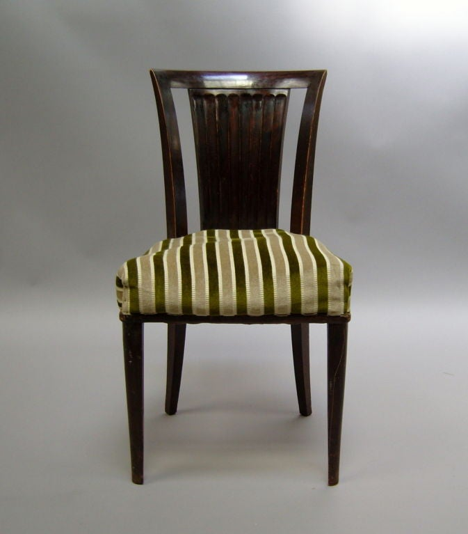 Set of six fine French Art Deco mahogany chairs by Gaston Poisson.