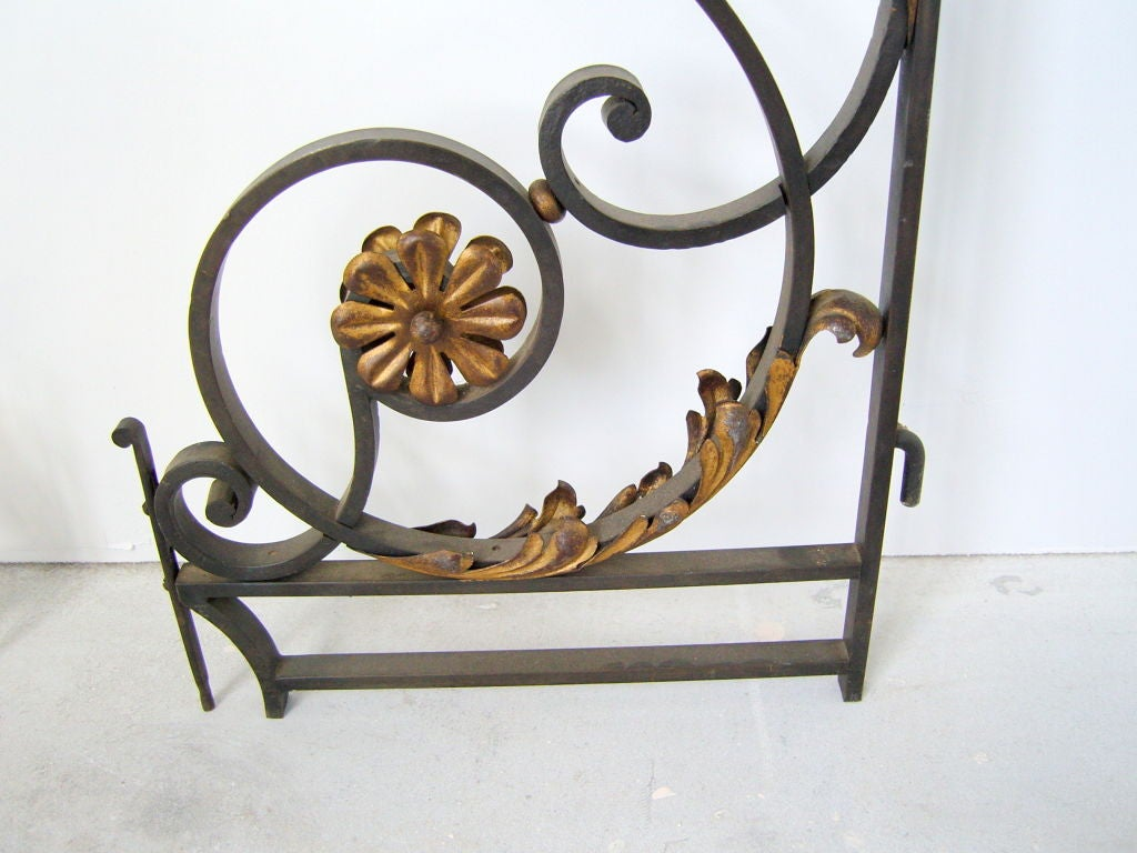Pair of fine French 1940s wrought iron gates with gilded details and original hardware.