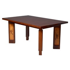 A Fine French Art Deco Walnut Dining Table
