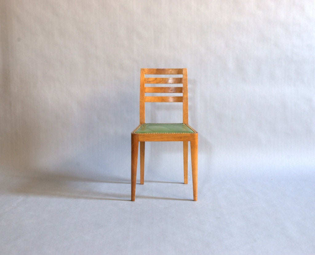 Set of eight French Art Deco cherrywood chairs.