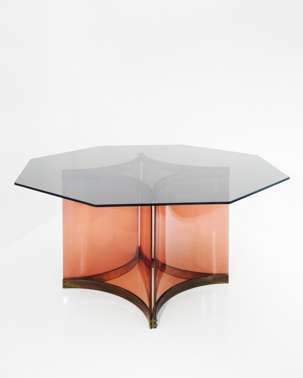 Smoked-glass top octagonal dining table with the designer's signature Perspex base.