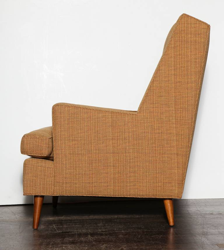 Tall back lounge chair by Edward Wormley for Dunbar. Great lounge chair with smart angles and roomy proportions. Conical wood legs and button detail to the seat back.