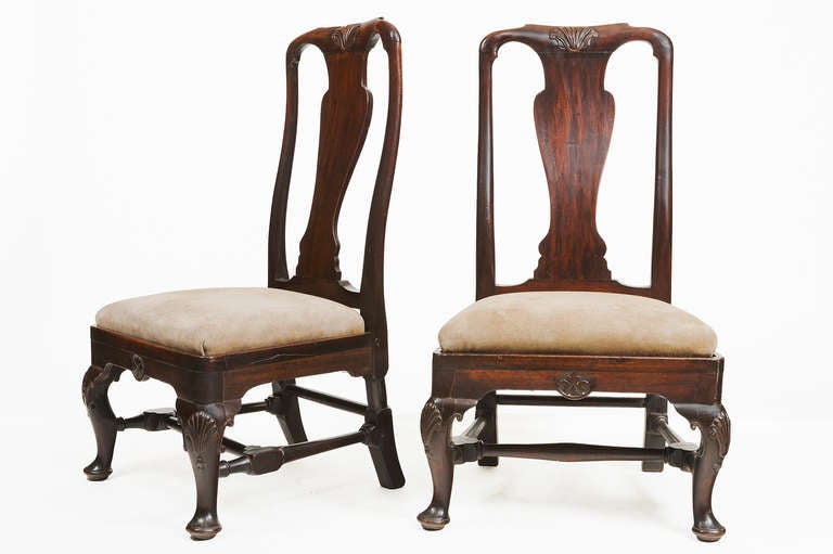 Pair of 18th century Georgian mahogany slipper chairs. With H-stretchers and cabriole legs carved with shells on the knees.