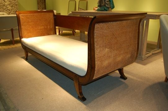 Beautiful settee by Carl Malmsten for NK, Sweden ca. 1940's.<br /> Rare cane sides with darkened birch burl.<br /> Burnished designers mark with metal NK tag.