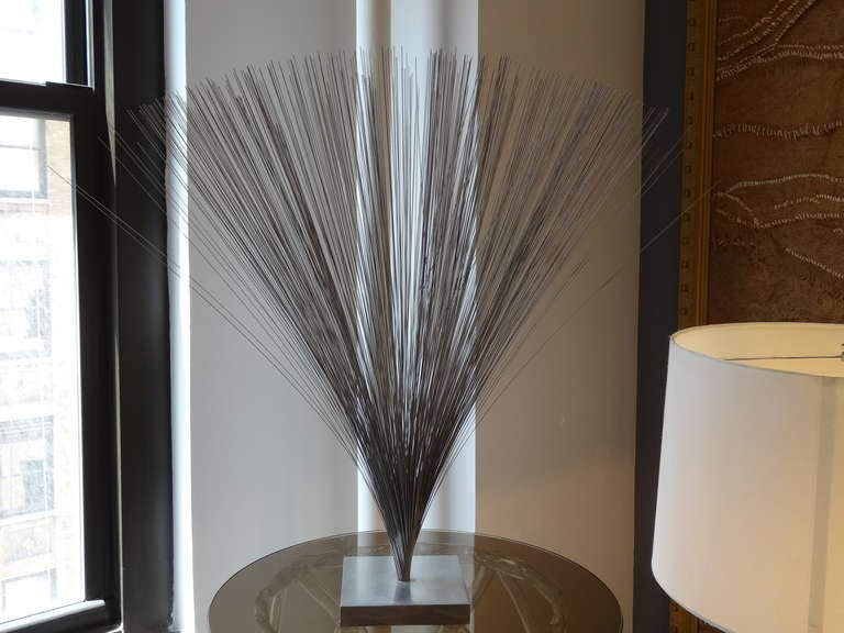 Bertoia style spray sculpture made of wire and with aluminium base.