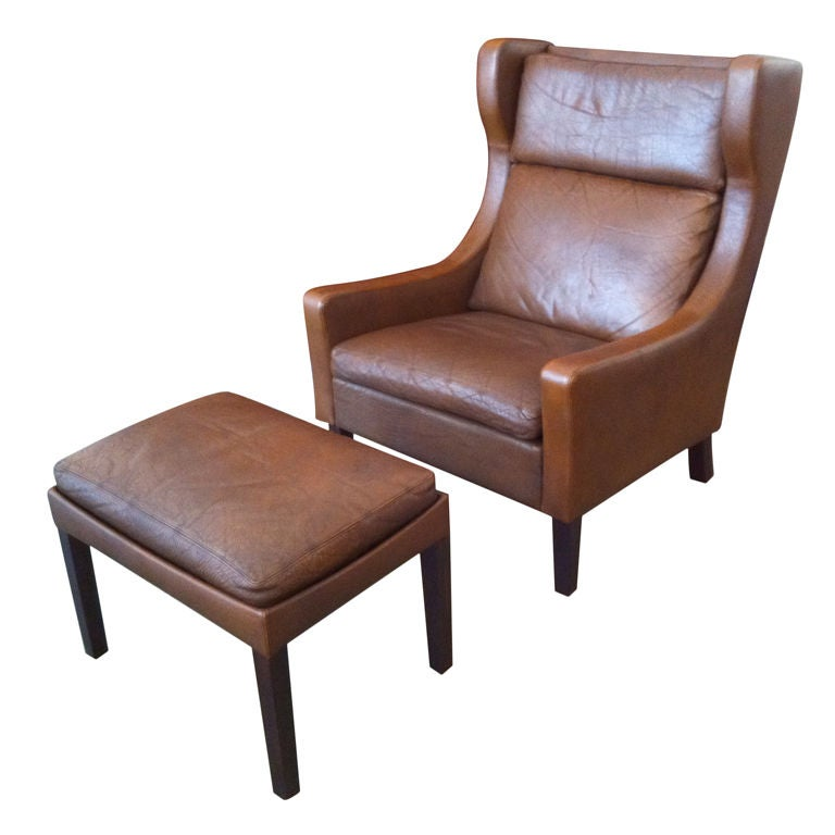 Danish Sixties Leather Wing Chair and Ottoman at 1stdibs