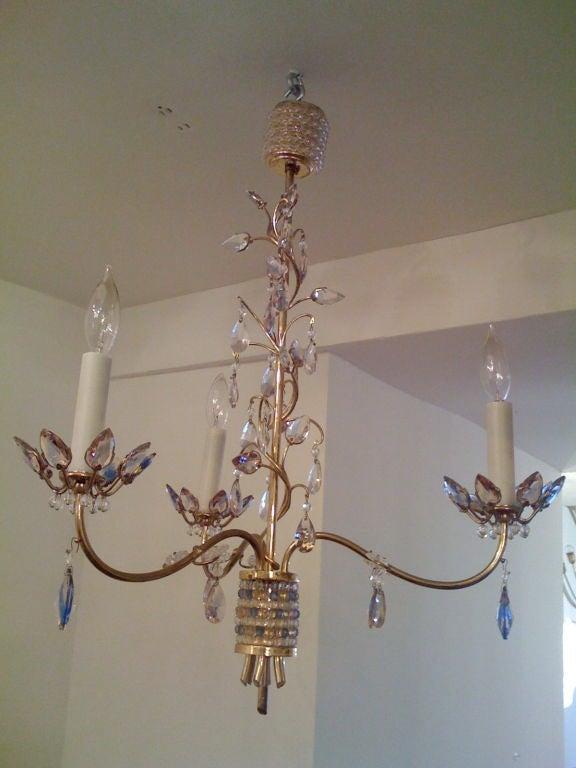 "A wonderful Austrian jewel toned crystal and brass chandelier designed by    Stefan Rath Hardtl for the ""Exposition Internationale des Arts Decoratifs et Industriels Modernes in Paris."