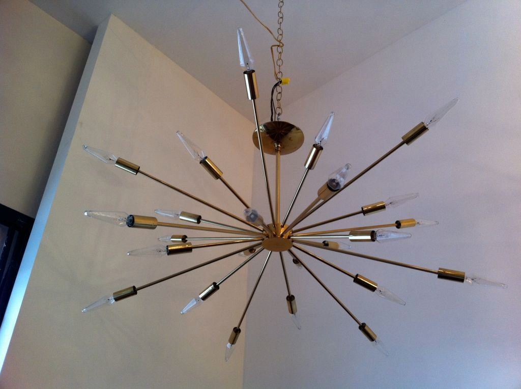 The original Sputnik designed light fixture by Gino Sarfatti. Solld brass parts. Made in a short production from 1954 - 1959.