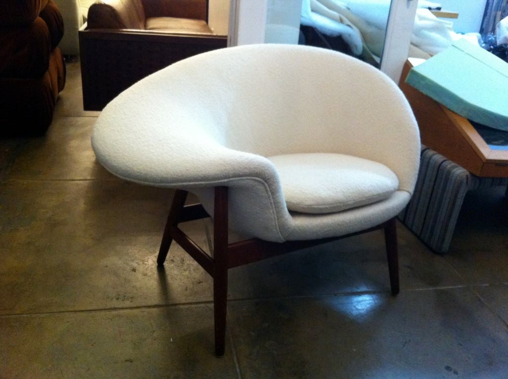 A rare iconographic design by Danish designer, Hans Olsen. The chair has been reupholstered in a white/cream Knoll Boucle fabric.