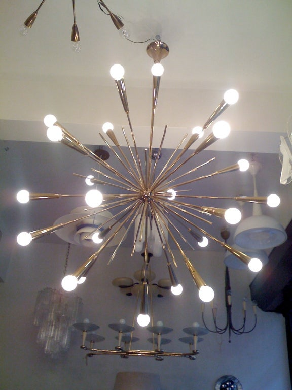 A grand pair of 1960s Italian brass starburst chandeliers. 24 light sources. Rewired and reconditioned. They came out of an Italian holiday resort. .