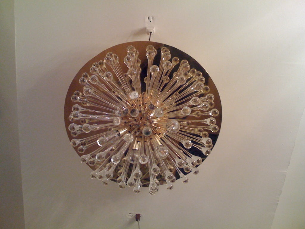 An Italian warm polished brass flush ceiling light with blown glass elements. A large reflector plate finishes off the chandelier. Six-light sources. Multiples available.