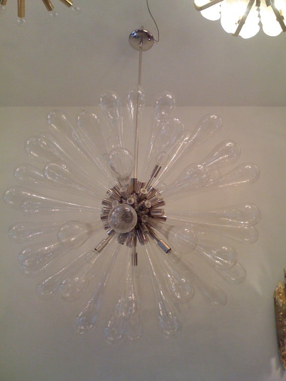 A large 36 inch diameter Murano glass and polished nickel Italian chandelier. Eight-light sources. Available at no extra cost in polished brass which makes it appear as a giant sun.