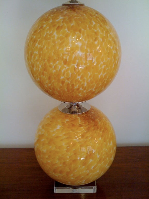 A beautiful pair of 1960s handblown Murano glass table lamps with chrome fittings and clear glass bases.