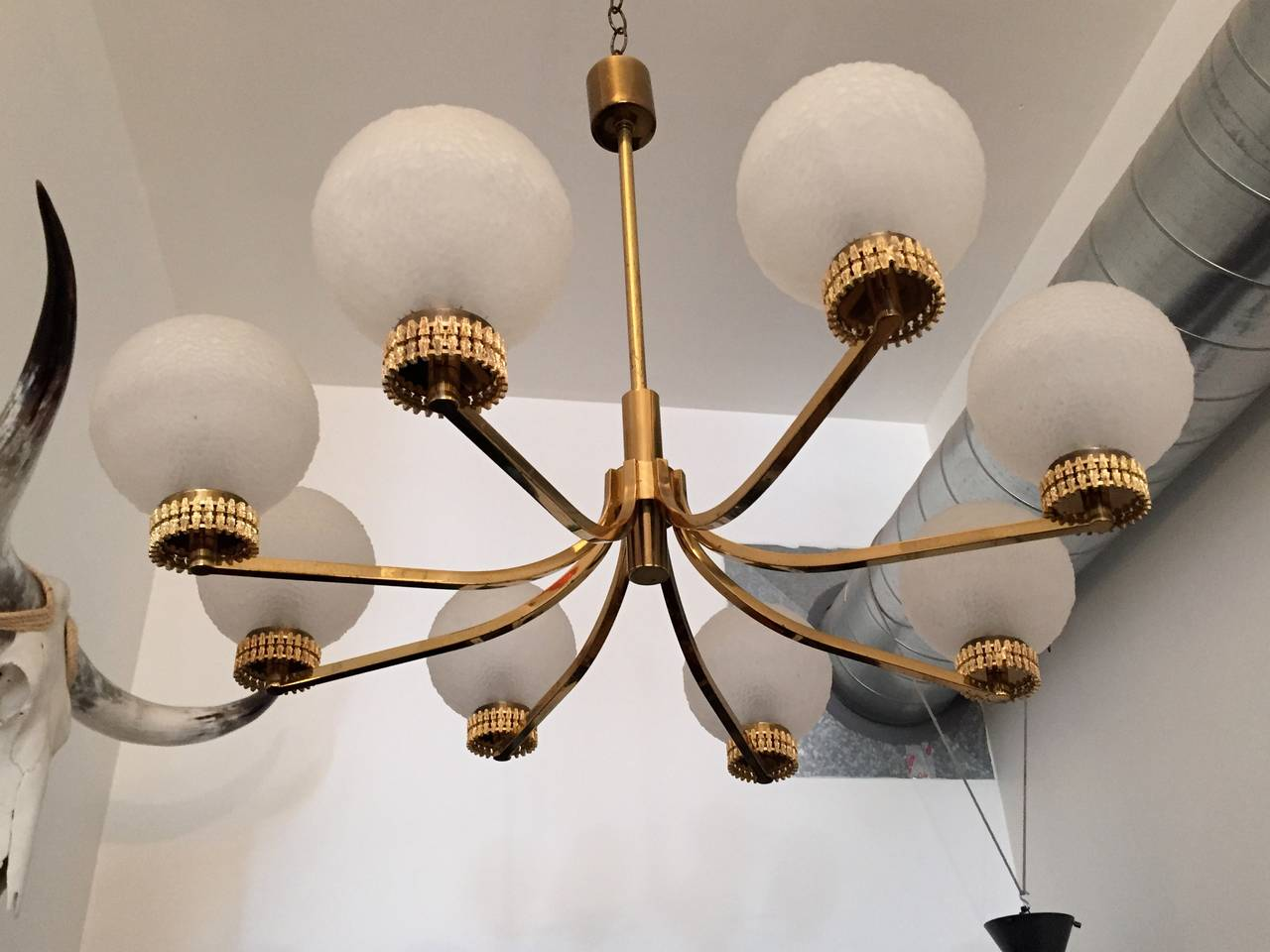 A glamorous 1970s German polished brass and gold-plated chandelier fixture with French textured deco glass globes. Rewired.