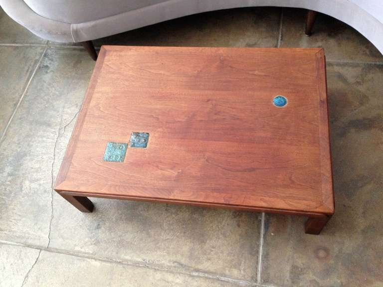 """A rare low 1950s sculptural walnut cocktail table with inset Natzler tiles. Measures: 18"""" H x 30"""" W x 22"""" W x 60"""" L."""