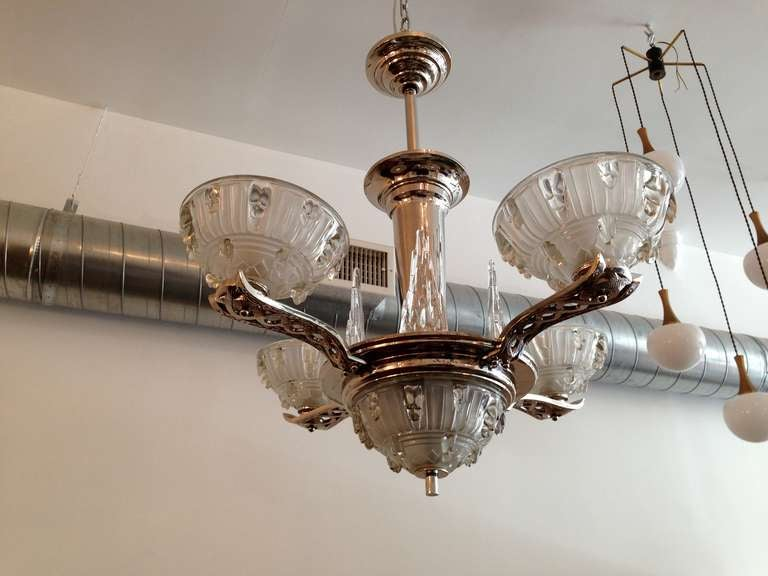 A great French Art Deco four light chandelier with clear/frosted glass shades and icecycle glass decorations. It has a polished nickel fixture. Rewired.