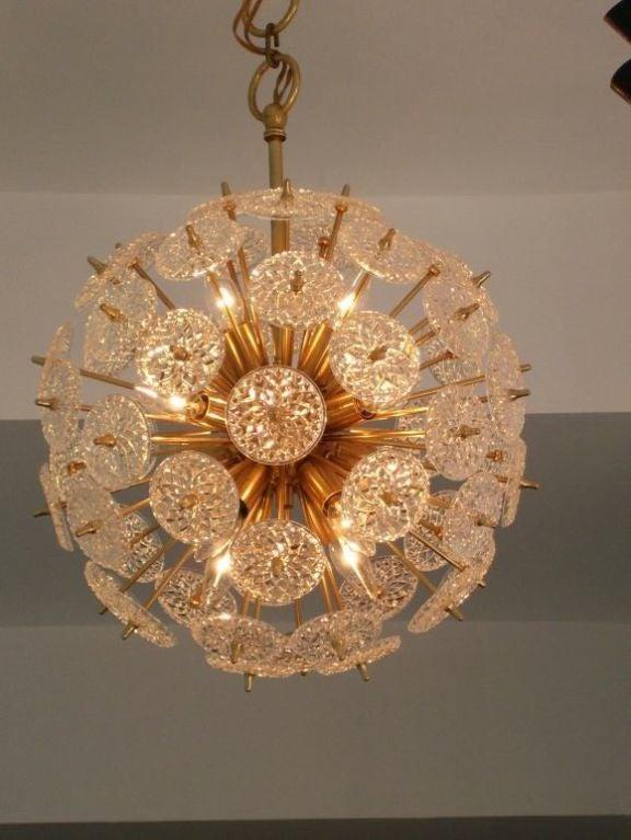 A beautiful pair of 1960's floral sputnik chandeliers. Brass. 10 light sources.