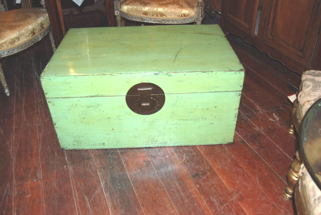 Simple lacquered Chinese trunk in vivid color.