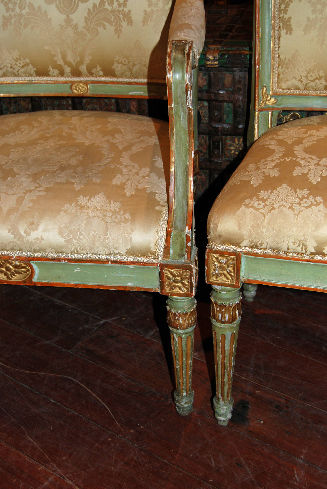 Painted and gilded Directoire dining chairs. Two armchairs and four side chairs.