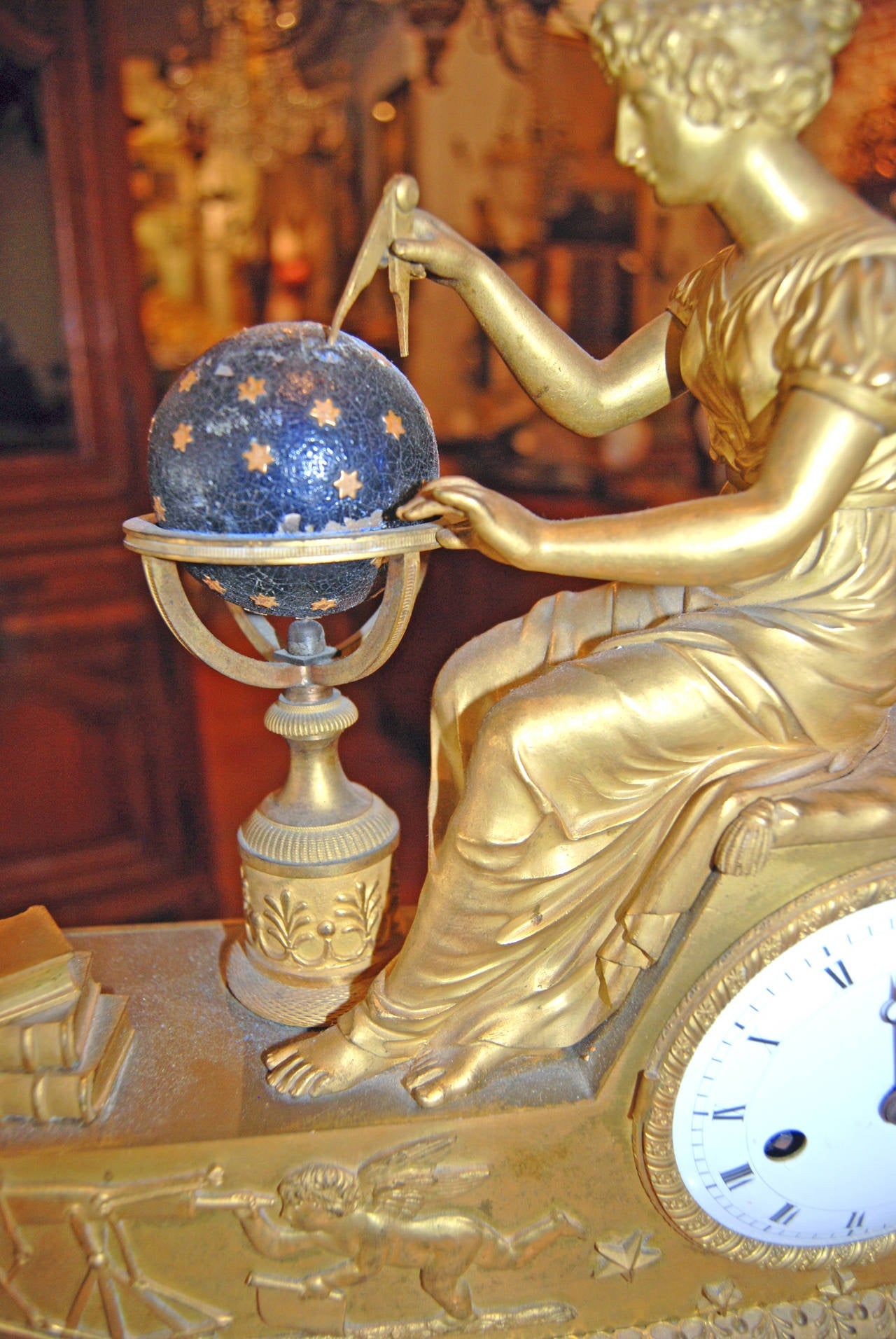 Beautifully chased bronze doré clock depicting the Goddess Urania with the symbols of Astronomy.