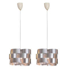 Pair of Max Sauze Metal Light Fixtures