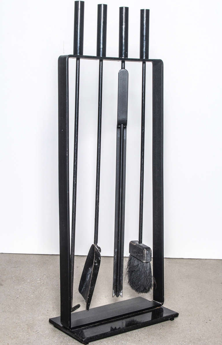 View this item and discover similar fireplace tools and chimney pots for sale at 1stdibs - Set of minimalist fireplace tools and stand in black iron by Pilgrim. USA