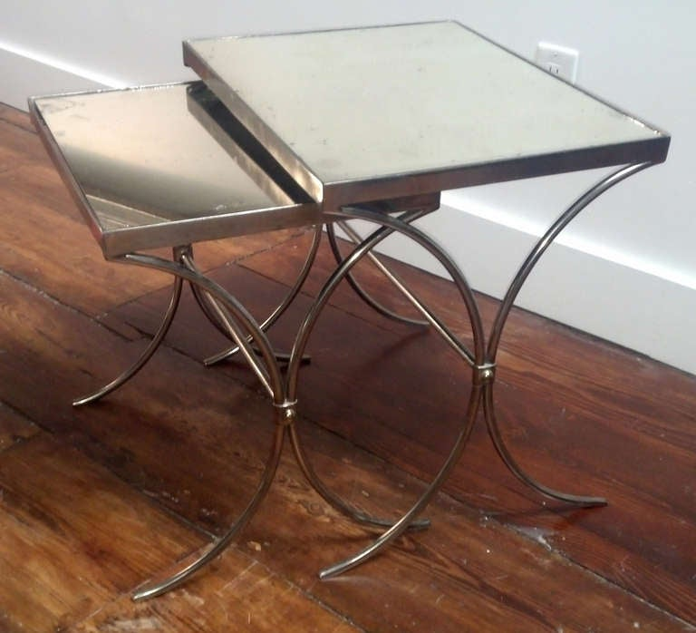 Pair of polished iron with patined mirror top nesting