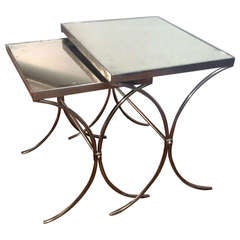 Pair of Polished Iron  with Patined Mirror Top Nesting Tables