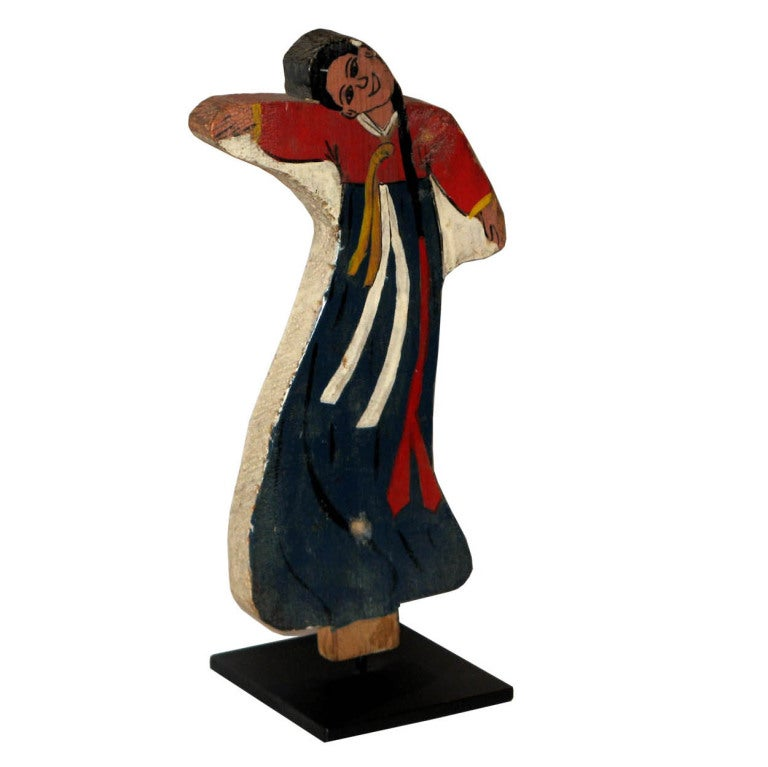 Vintage Korean Folk Art wood dancing doll with handpainted traditional costume used in shaman ceremonies, circa 1920s.