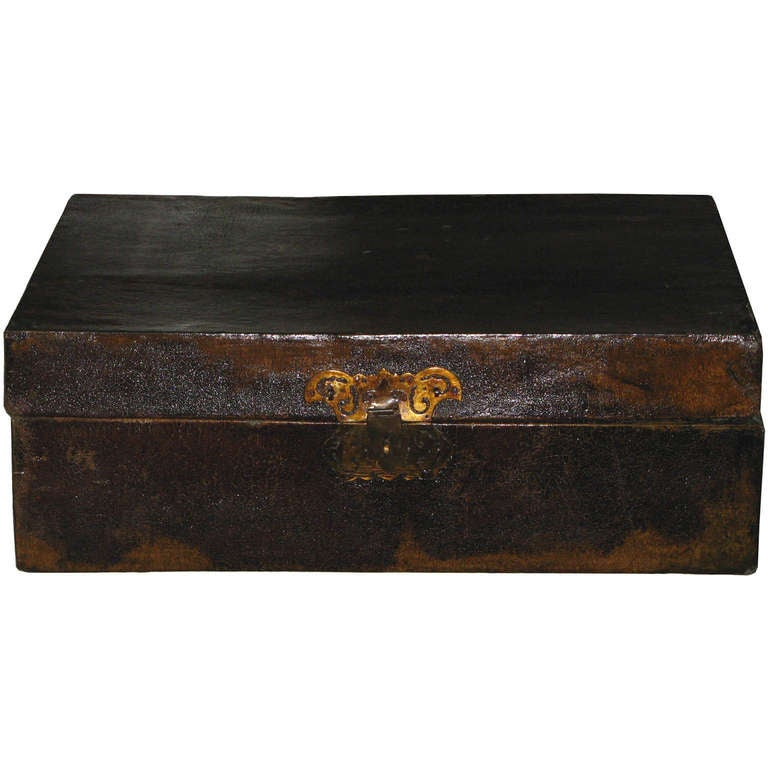 Antique leather box with original butterfly hardware was used as a traveling suitcase. Well preserved inside lining shows original oiled paper. New back hinges, circa 1880s.