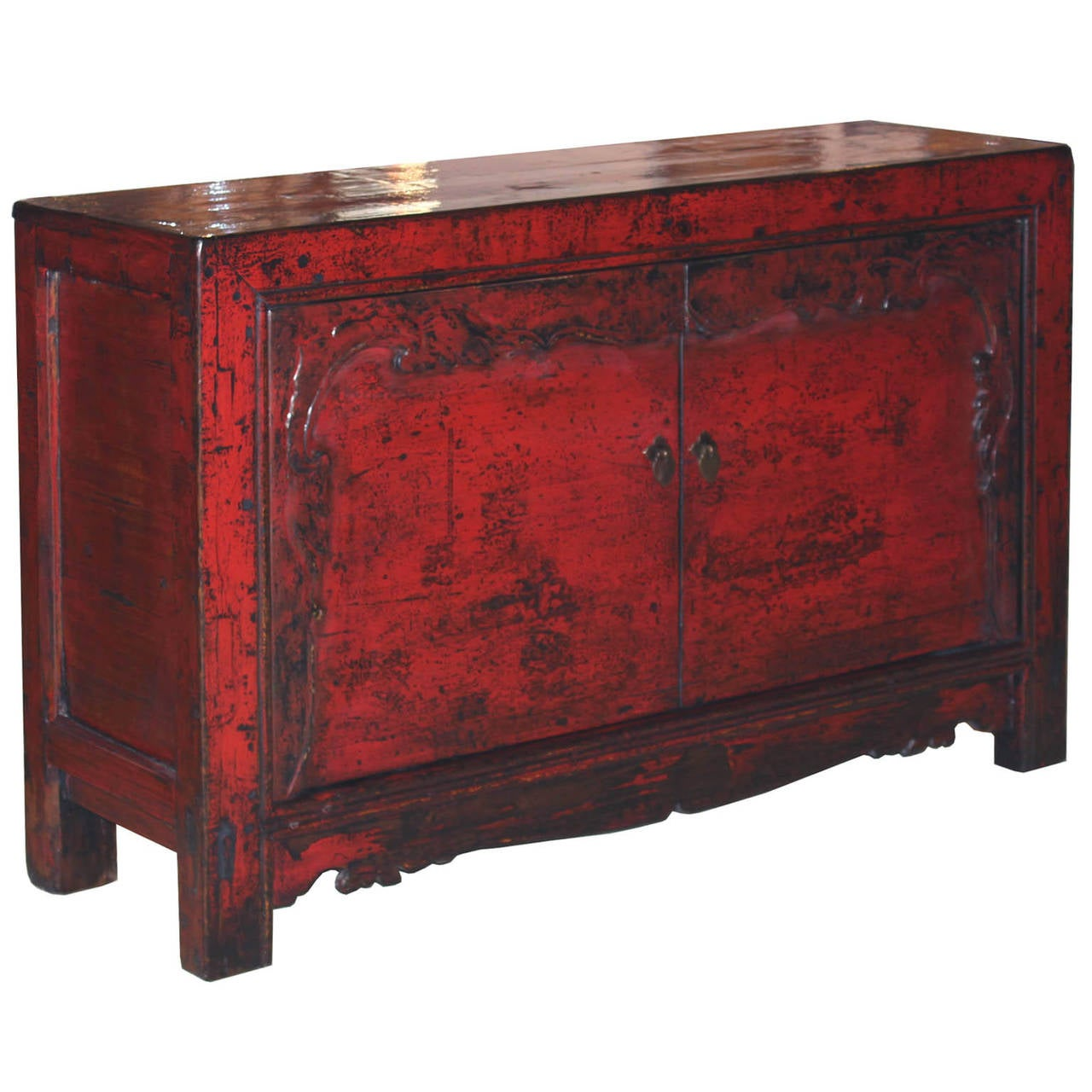 Two-door buffet with red lacquer. Hand-carved doors with green borders and carved bottom skirt. New interior shelf and hardware. Gansu, China, circa 1890.
