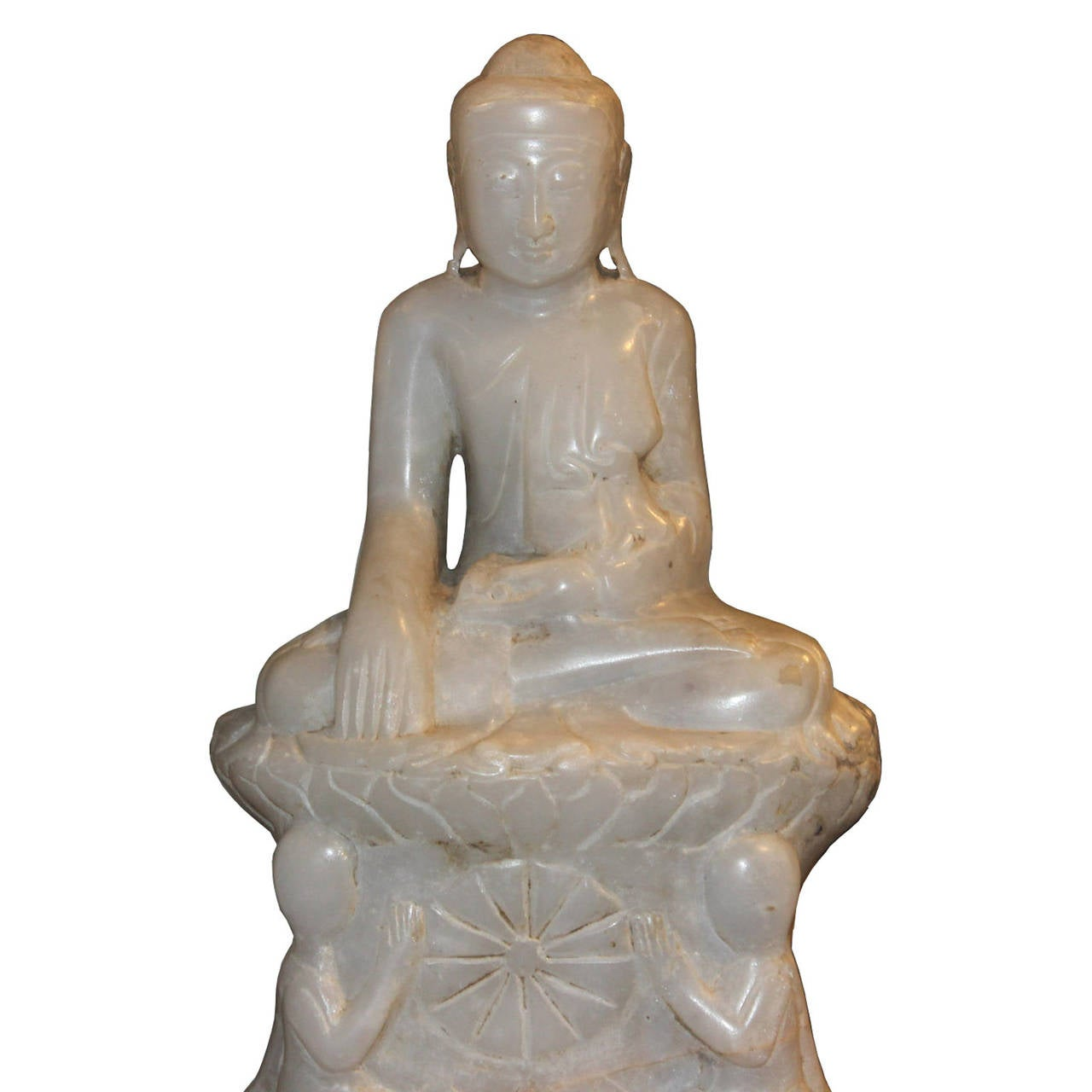 Hand-carved marble Burmese Buddha is sitting with bhumisparsha mudra or earth touching gesture with two monks praying below. Place on a console table in an entryway or on a bookshelf.