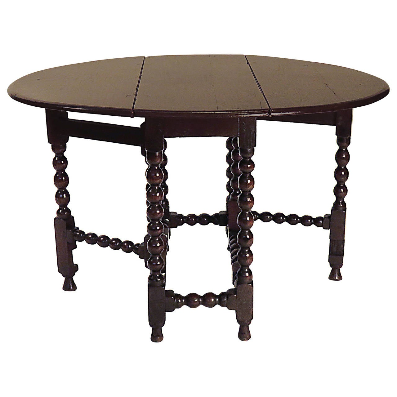 Charles II Provincial Round English Oak Drop Leaf Table, Circa 1680 For Sale