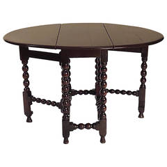 Charles II Provincial Round English Oak Drop-Leaf Table, circa 1680