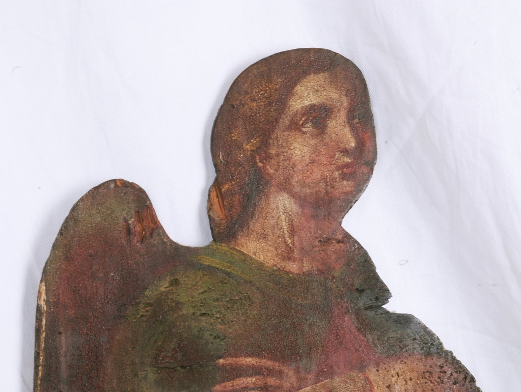 A rare large painted angel made to decorate a rustic chapel. We think this piece is Italian and from the early 19th century, circa 1800. Wonderful old painted surface with a dry original finish. On a later custom stand.