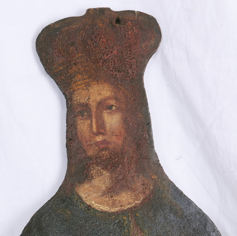 A large and decorative painting of a crowned saint. This was made for decoration in a rustic chapel. We think it is from the countryside of Italy and date it to the first part of the 19th century. Later custom iron stand, circa 1800.