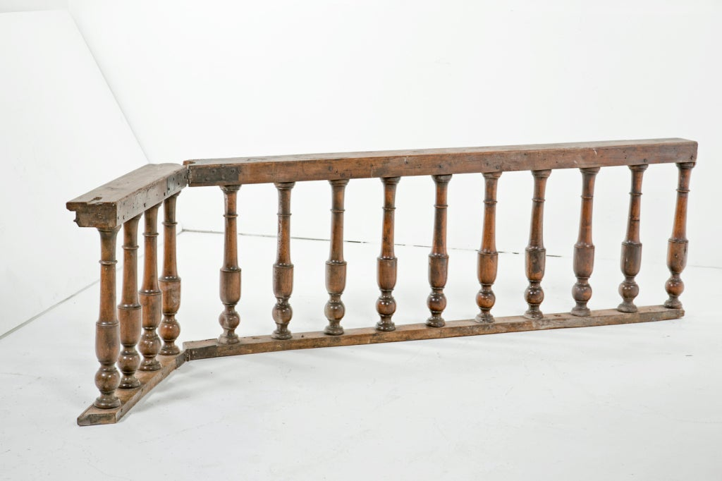 """A rare and wonderful pair of walnut balustrades with folding openings. These where made in Italy in the 17th or 18th century. One of two sections shown. Great for a table base or for a set of 28 matching lamps. Long section measures 80.5""""."""