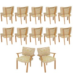 A set of 12 Paul Laszlo Dining Chairs