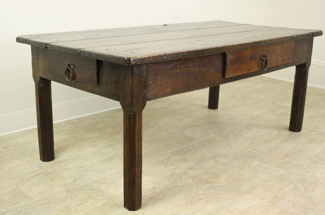 This is a nice chunky rich dark oak coffee table in a practical 53x27