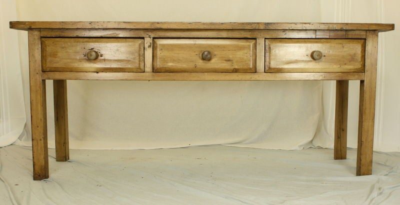 "A very good looking chunky pine console with a simple and versatile Silhouette. Good shaped drawer fronts. The three roomy drawers, measuring 6"" deep and 20"" across, provide good storage. Very clean lines and a rich patina. This sideboard"
