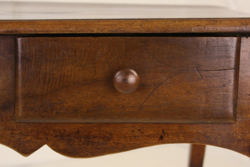 A lovely, Classic, 18th century Louis XV table, suitable for many uses. Its smaller size allows it to be a good end table, a nightstand, and even a small desk, as the height is appropriate, with a small chair. Two drawers, graceful shaped aprons,