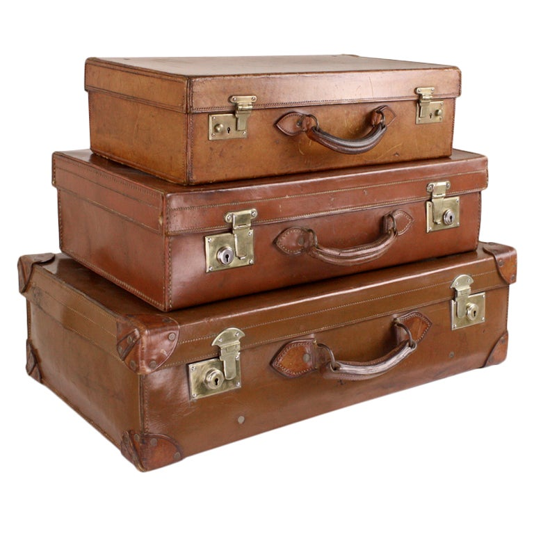 Stack Of Three English Leather Suitcases at 1stdibs