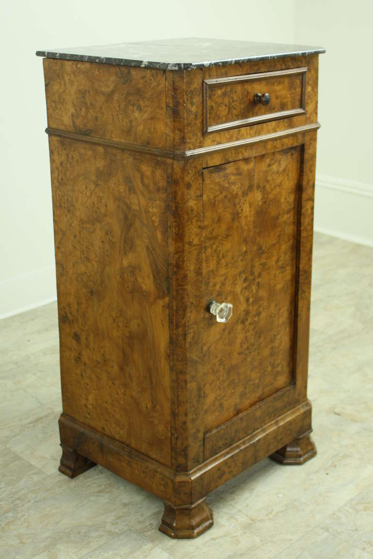Terrific graining on this burr elm, with a nice marble top.  Sweet little drawer with a molded edge, and a hand-turned small knob.  Lovely classic Louis Philippe feet.  Great storage for a practical and handsome night stand. Correct height for a