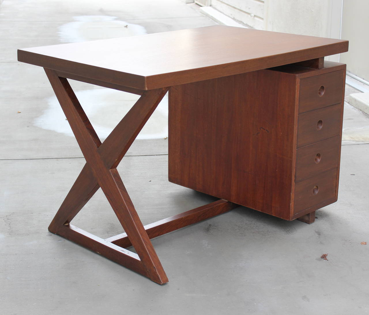 Pierre Jeanneret bureau of administration desk in solid teak. Metal inset for drawer pulls. Chandigarh, India.