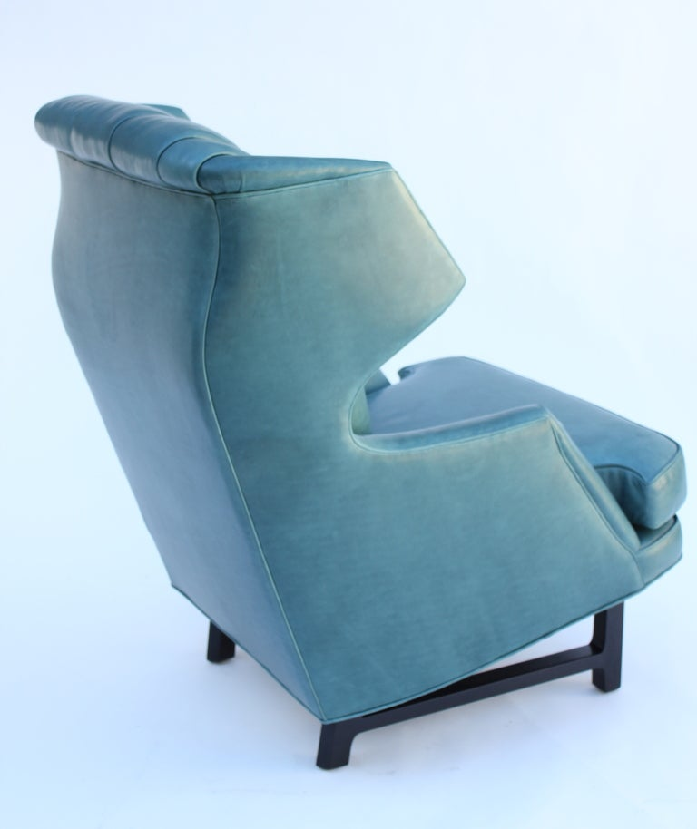 Classic Janus collection wing chair. Designed in 1957 for the Dunbar's most well heeded collection, Janus by Edward Wormley. Leather Upholstery and signed with the original decking.