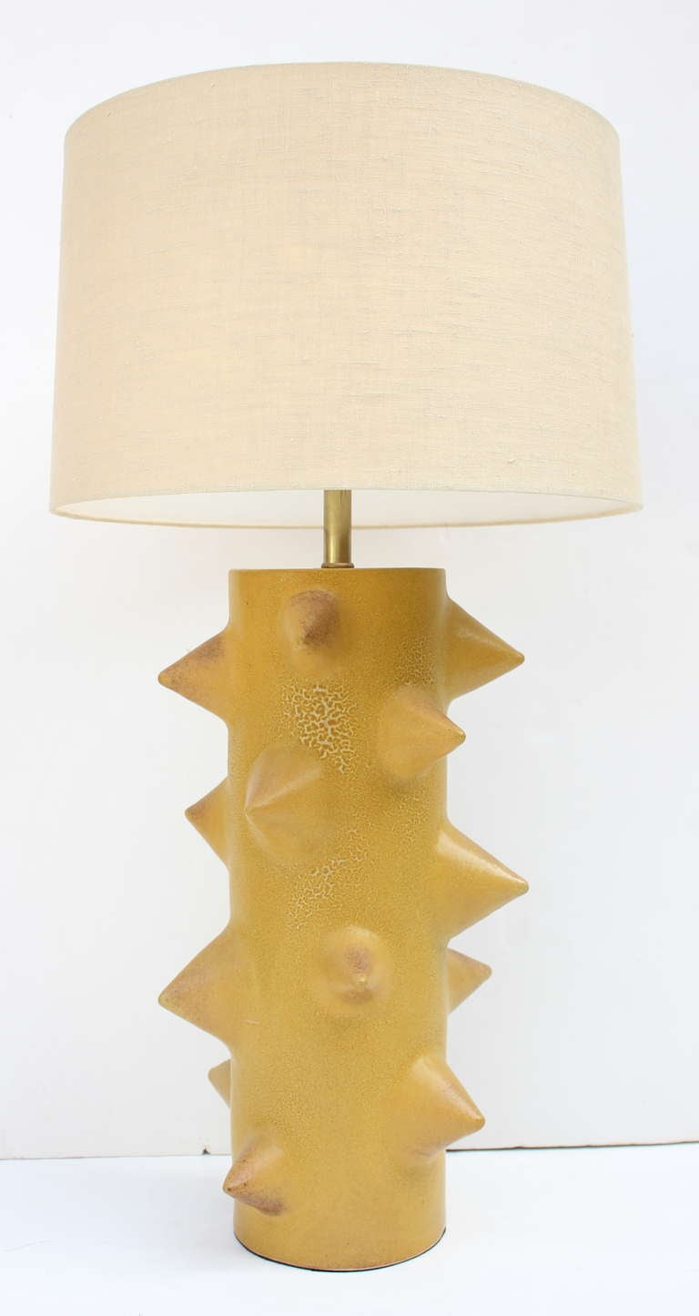 Warner Walcott Stoneware Lamp exclusively for Downtown. Custom Glazes available. Lamp shown with nickel double cluster, twist cord. Matte Glaze Ceramic Finial. Walnut top .